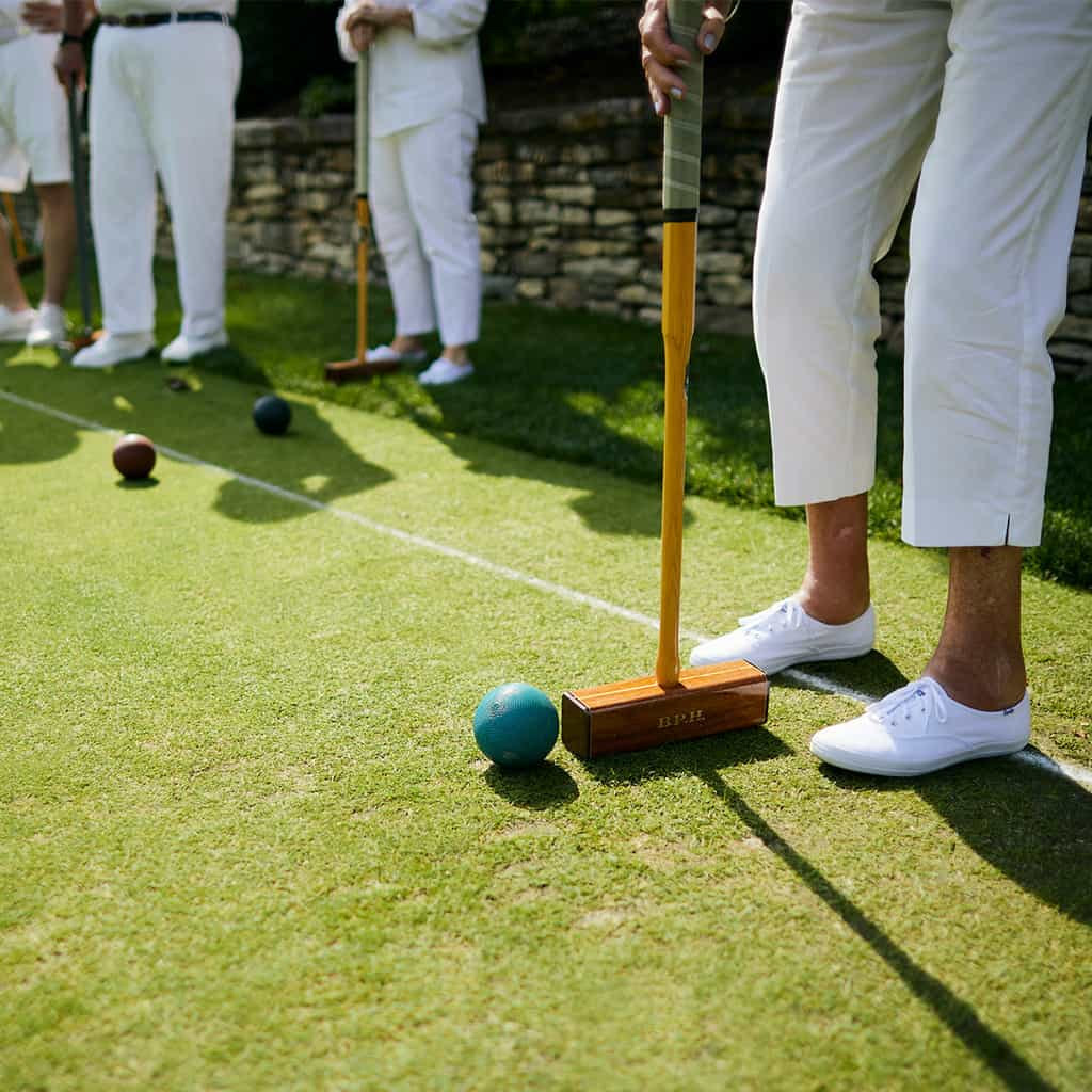 Person hitting croquet ball at Peachtree Hills Place, a 55+ independent living community